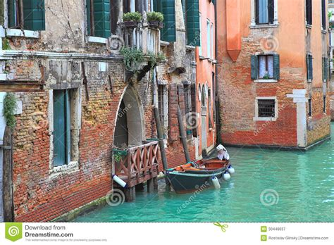 small boat venice boat and old brick house in venice italy stock image