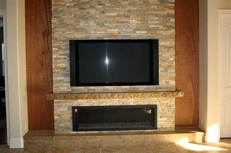 custom stone fireplace tv wall s d m custom finish stone fireplaces pictures tv fireplace mantel kits with