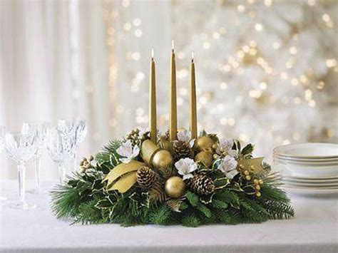 composizioni di candele centrotavola natalizio