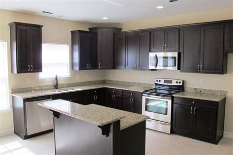black and brown kitchen cabinets black cabinets kitchen glass access door storage ideas