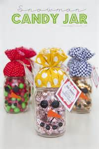Toss some candy in a jar add a little snowman love and let others