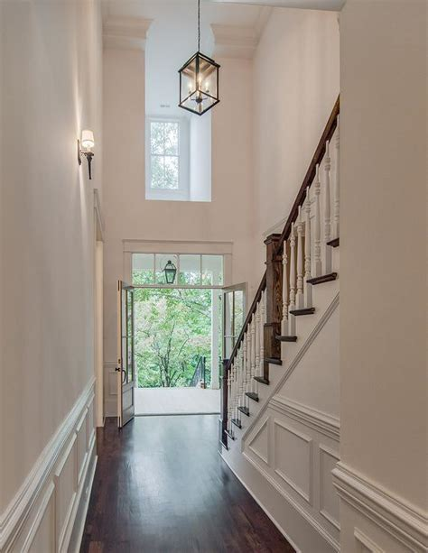 2 story foyer lighting two story foyer with carriage lantern and stained