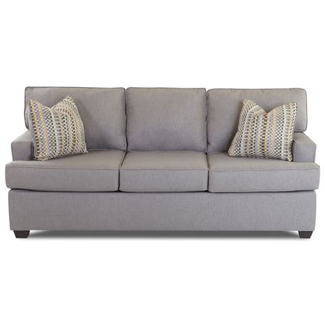 contemporary sleeper sofa with track arms and sized air coil mattress by klaussner wolf