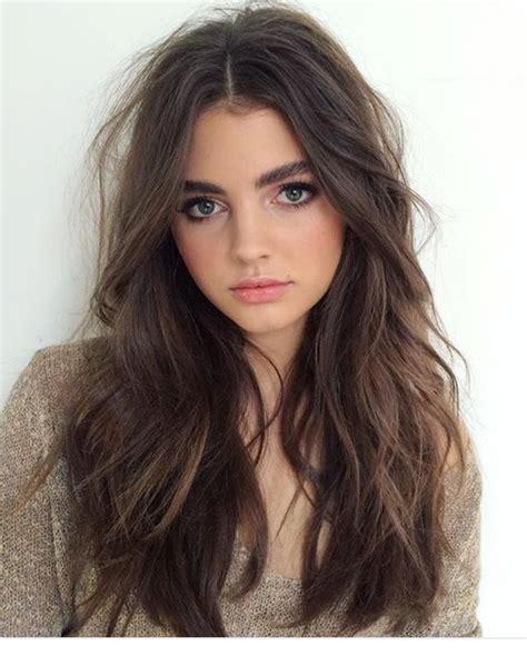 hair parting comes forward long natural wavy hair brunette centre parting hair