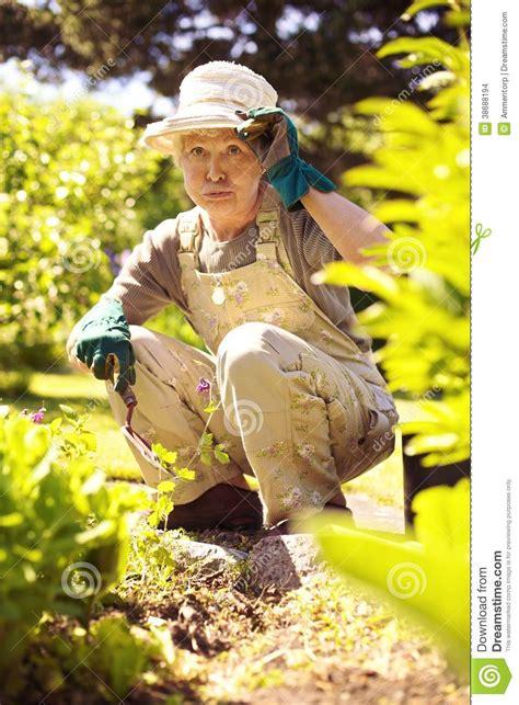 Backyard For Seniors Working In Garden Feeling Tired Stock Images