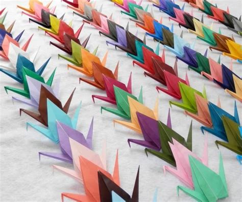 100 small origami cranes in 100 different rainbow colors