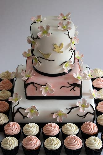 Simple Wedding Cake And Cupcakes by Photo