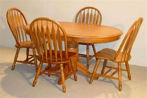 oak kitchen table and chairs oval solid oak table set in golden finish