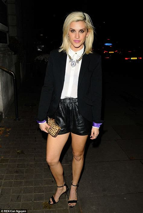 ashley roberts looks leggy as she braves the elements in