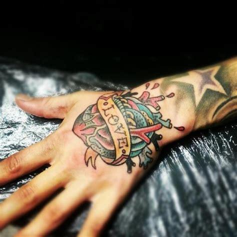 tattoo on hand new new school heart hand tattoo by stay true tattoo