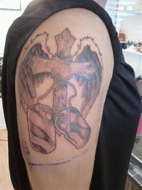 tattoo removal athens ga black and gray cross wings with tags dawg