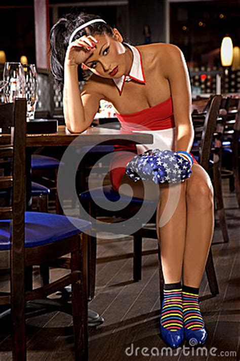 zales commercial actress brunette restaurant table waitress girl of commercial restaurant in uniform stock