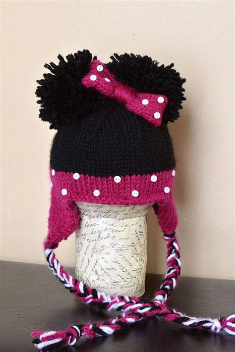Pom 10 Stelan Minnie Black minnie mouse knit earflap hat in black and pink with pom pom ears for 0 3 months