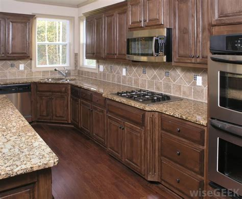 how to clean kitchen cabinets grease how do i clean kitchen cabinets since the culprit is usually grease it s important to