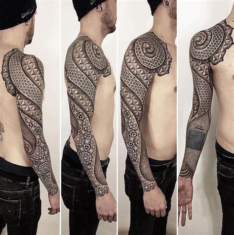 Kaos Dflow Black geometric sleeve tattoos visually crystalize across the