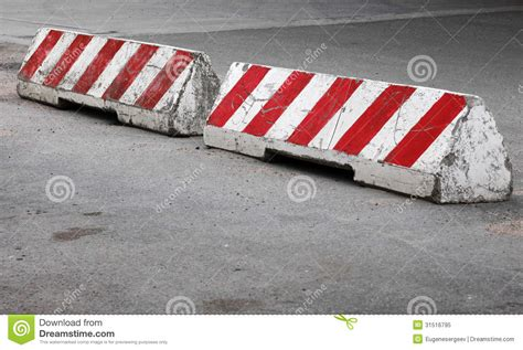 Road Barrier 9 11 and white striped concrete road barriers royalty free