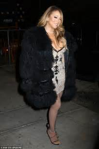 Careys Fur Coat Is Lost In The Mail by Carey Puts On Eye Popping Display In Low Cut Mini