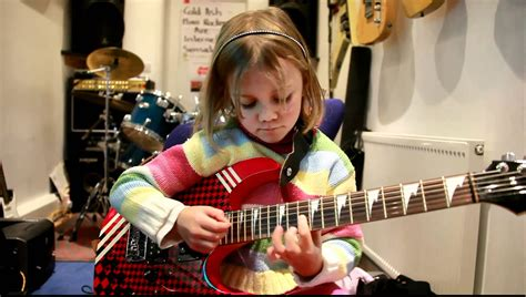 child nonued 7 years 7 year old mini band guitarist zoe thomson plays sweet