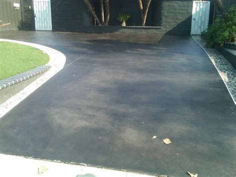 Black stained concrete   Orange County   by Joe's Premium Painting