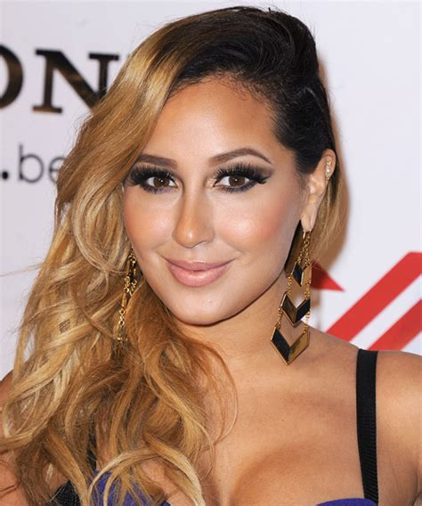 adrienne bailon hair color adrienne bailon wavy casual hairstyle golden