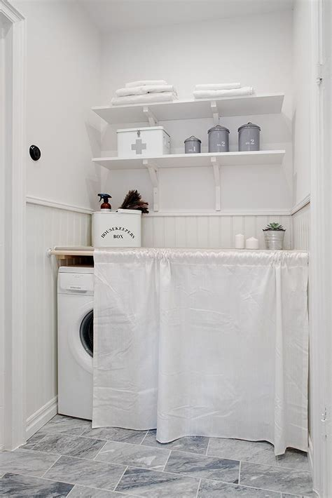 how to hide washer and dryer crisp clean laundry room with a white sheet to hide
