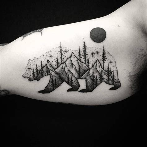 blackwork tattoo with bear and mountains