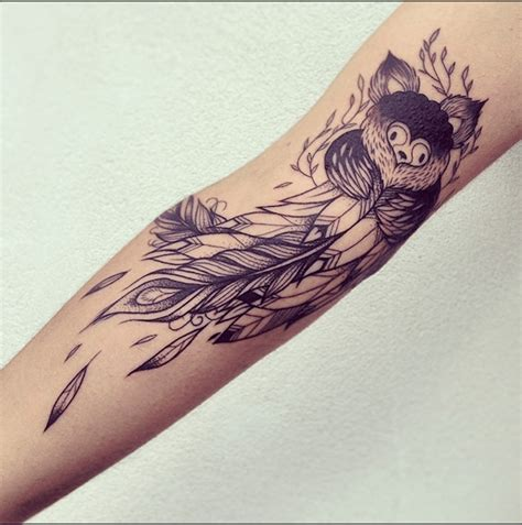 what do feather tattoos mean owl and feather on arm sleeve