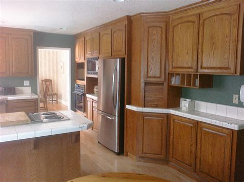 updating oak kitchen cabinets update from oak tile to white painted cabinets granite