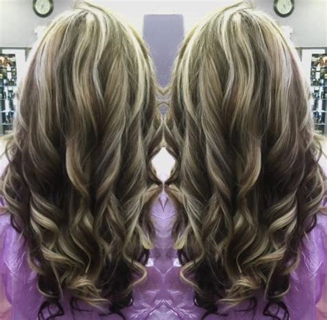 sark hair on top light on the bottom dark brown lowlights and light blonde highlights on golden
