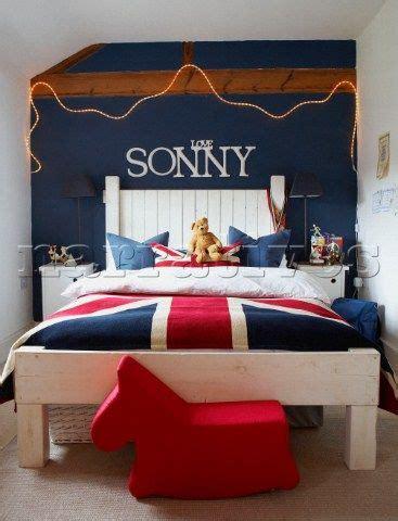 boys bedroom  union jack bedlinen  blue painted wall  love sonny  white lettering