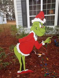 grinch steals christmas yard decoration
