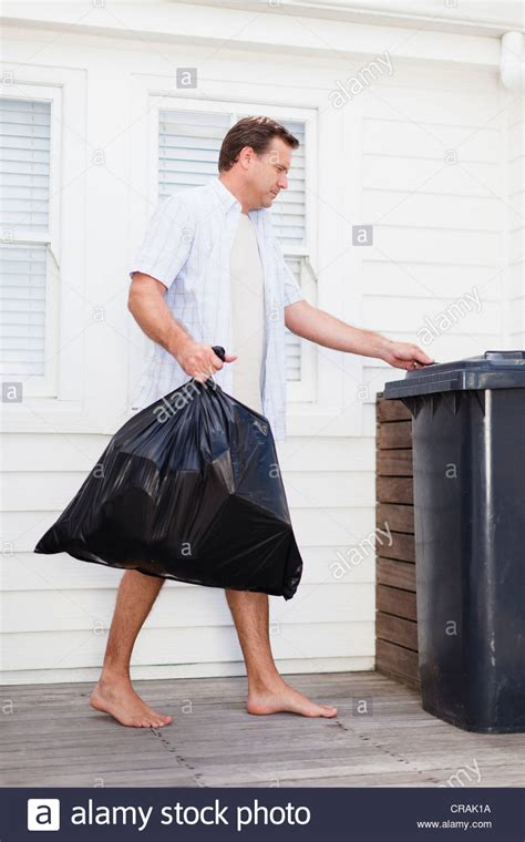 Taking Out The Trash With by Taking Out Garbage Stock Photo Royalty Free Image