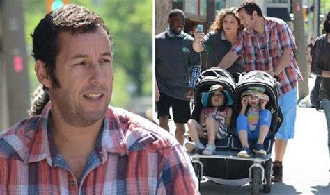 s day adam sandler adam sandler pushes daughters 8 and 5 in a