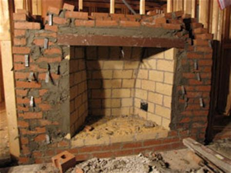 Build An Indoor Fireplace by An Builds A House Day 101 Fireplaces 101