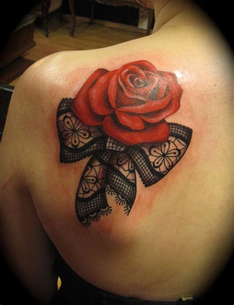 black and red rose tattoo and black ribbon