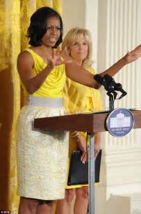 yellow curtain behind obama ouch that s bright michelle obama and jill biden co