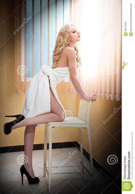 bathroom blonde young blonde woman wrapped in white towel looking on the