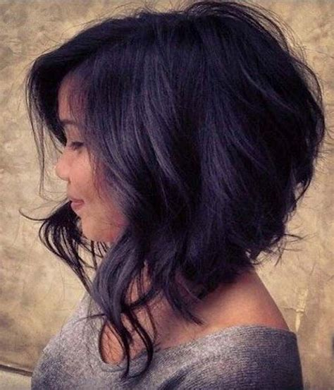 hair cut with a defined point in the back this angel cut bob with feminine loose wavy everything