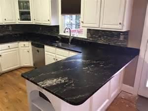 titanium granite countertops with white cabinets