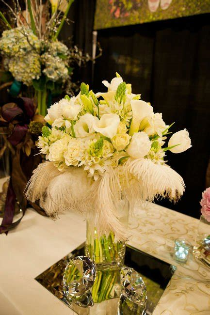 centerpieces with feathers and flowers centerpieces