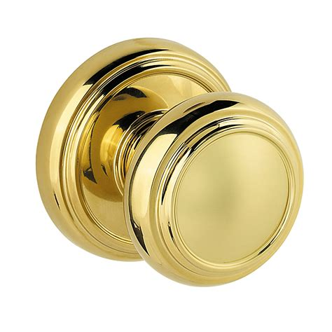 baldwin prestige series alcott door knob in polished brass