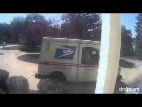 Does Usps Deliver To Your Door by Usps Mailman Throwing A Delivery Package At Door Don