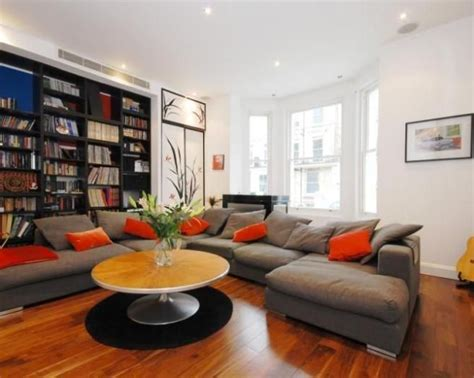 orange and beige living room photo of contemporary japanese beige black grey orange white living room lounge with bookcases