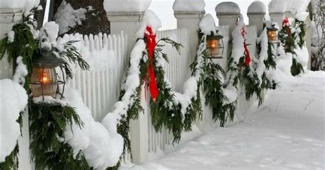 white picket fence decorated  christmas     norman rockwell scene garden