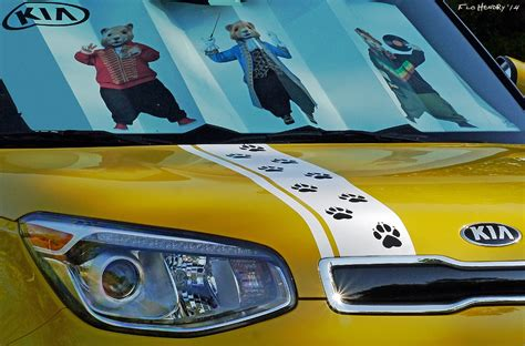 yellow painted soul exclaim with white rally stripes kia