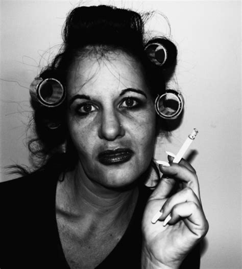 smoking in curlers woman in hair curlers smoking a cig scary woman