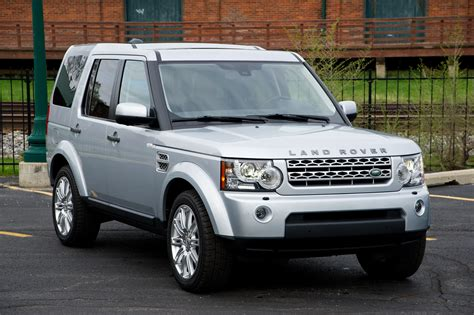 silver land rover lr4 comparison test land rover lr4 vs cadillac escalade vs