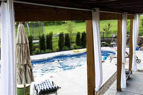 hanging outdoor curtains use chain link fence poles and hardware to make outdoor