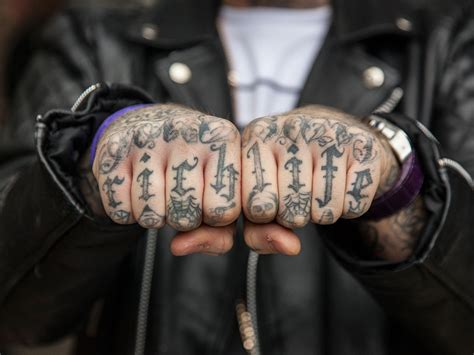 knuckle up tattoo quot and tattooed on the knuckles of his