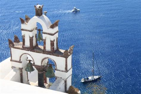 Design A House Online 3 bells with 2 ships in the water oia santorini greece